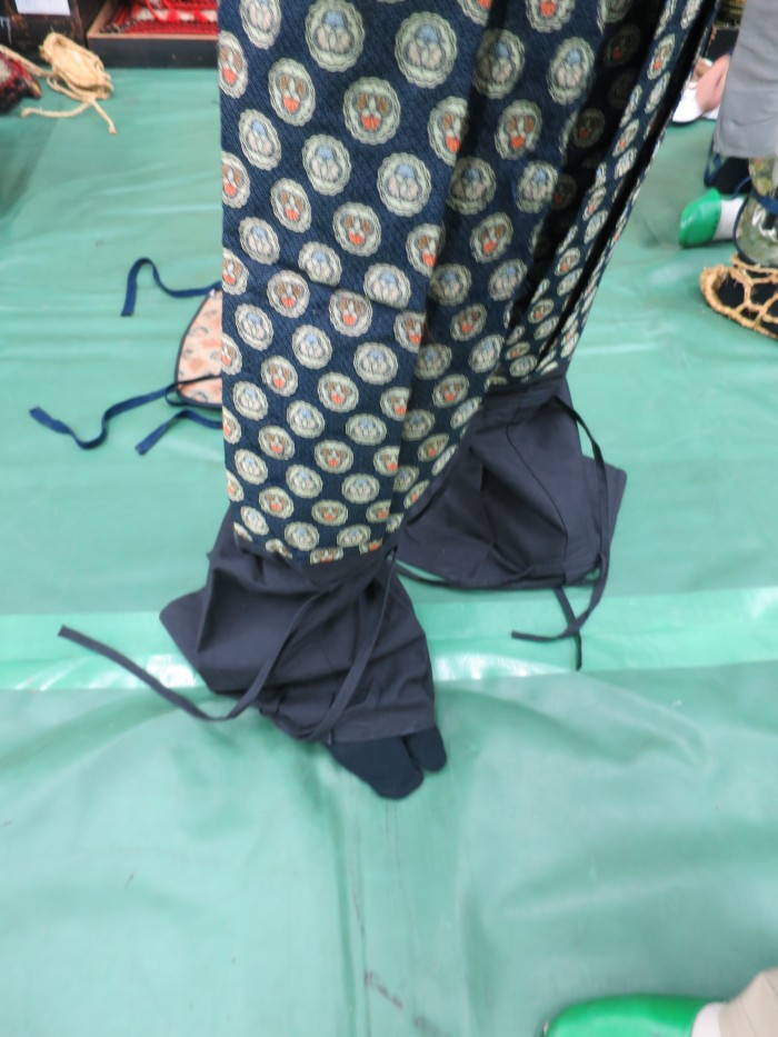 The pants will be covered with the blue cotton which is preparation for the leg protector added on later.