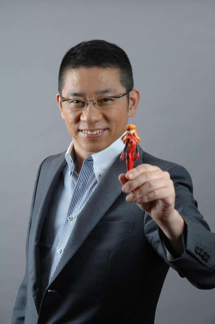 Japanese futurist Morinosuke Kawaguchi with a figure of Asuka chan