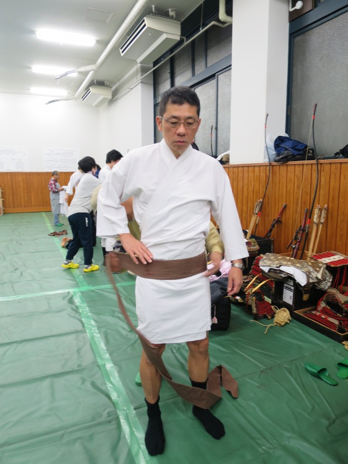 First piece of clothing is a cotton Japanese style shirt which is tied very tightly with a long cloth. This is an important step to make sure the rest of the outfit fits well, allowing comfortable movement while keeping the body very tight so the weight of the samurai yoroi is not even felt.